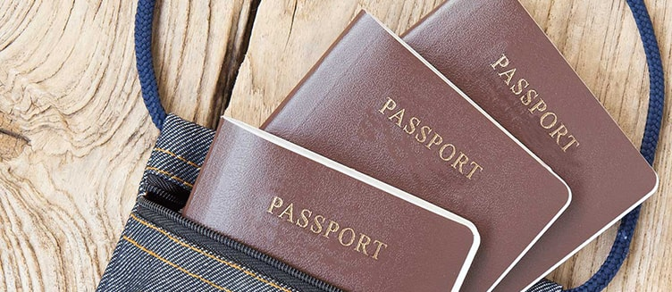 Should I surrender my passport, original degree, and original teaching certificate to my school?